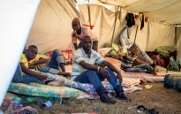 FILE: Young Malawian men sit inside their tent in the Isipingo camp on 25 April 2015, which has become a temporary home for people displaced by xenophobic violence in Durban. Picture: Aletta Gardner/EWN