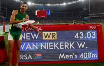 South Africa's 400m Olympic gold medallist Wayde van Niekerk points to his new world record displayed on a board after the Men's 400m Final at the Rio 2016 Olympic Games at the Olympic Stadium in Rio de Janeiro on August 14, 2016. Picture: AFP