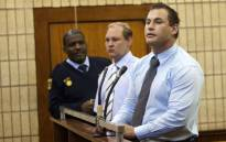 (L) Zane van Tonder and Rudolph Viviers (R) appear in the Krugersdorp Magistrate's Court on Tuesday, 21 August 2012 on murder charges after the death of Mohammed Fayaaz Kazi from Ventersdorp. Picture: Sapa.
