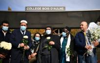 Imam of Drancy Hassen Chalghoumi (2nd L) and French Jewish writer Marek Halter (C) attend a gathering of imams outside the Bois d'Aulne secondary school in homage to slain history teacher Samuel Paty, who was beheaded by an attacker for showing pupils cartoons of the Prophet Mohammed in his civics class, on 19 October 2020, in Conflans-Sainte-Honorine, northwest of Paris. Picture: AFP
