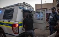 Suspects are loaded into a police van after being arrested for looting in Troyville, Johannesburg on 2 September 2019. Picture: Thomas Holder/EWN