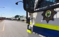 FILE. Police vehicle monitors protesters in Johannesburg. Picture: Vumani Mkhize/EWN