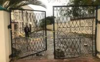 A police tape is seen at the entrance of a mosque in Malmesbury, where a man stabbed two worshippers to death. Picture: Shamiela Fisher/EWN.