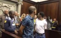 Nigel and Johannes Plaaitjies are escorted out of the Western Cape High Court after being sentenced to life in jail for the murder of Afrikaans author Winnie Rust. Picture: EWN.