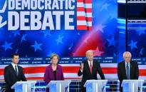 Democratic presidential hopefuls (L-R) Mayor of South Bend, Indiana, Pete Buttigieg, Massachusetts Senator Elizabeth Warren, Former Vice President Joe Biden and Vermont Senator Bernie Sanders speak during the fifth Democratic primary debate of the 2020 presidential campaign season co-hosted by MSNBC and The Washington Post at Tyler Perry Studios in Atlanta, Georgia on 20 November 2019. Picture: AFP