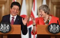 British Prime Minister Theresa May (R) and Japan's Prime Minister Shinzo Abe (L) hold a joint press conference at 10 Downing Street in central London on 10 January 2019 following talks. Picture: AFP