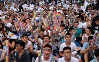 Same-sex activists hug outside the parliament in Taipei on 24 May 2017 as they celebrate the landmark decision paving the way for the island to become the first place in Asia to legalise gay marriage. Picture: AFP