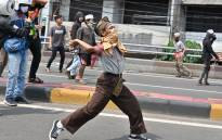 Protesters hurl rocks toward police during a clash in Jakarta on 22 May 2019. Picture: AFP