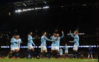 Manchester City's English midfielder Raheem Sterling (3R) celebrates scoring his team's sixth goal during the English Premier League football match between Manchester City and Burnley at the Etihad Stadium in Manchester. Picture: AFP.