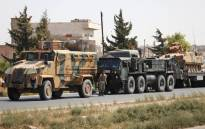 FILE: Turkish forces are seen in a convoy on a main highway between Damascus and Aleppo, near the town of Saraqib in Syria's northern Idlib province, on 29 August 2018. Picture: AFP.