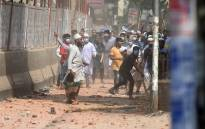 Activists from Islamist groups clash with the police as they protest against the visit of Indian Prime Minister Narendra Modi in Dhaka on 26 March 2021. Picture: Munir Uz zaman/AFP