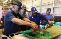 Police Minister Bheki Cele (L) briefed the media at the South African Police Service (SAPS) central liquor storage facility in Belhar, Cape Town, on 2 January 2018 where 10,000 litres of alcohol was destroyed. Picture: @SAPoliceService/Twitter