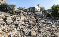 A member of Hamas' military police walks through rubble at a site that was hit by Israeli air strikes in Gaza City on 9 August 2018. Picture: AFP