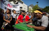 FILE: A UCT FeesMustFall protester drums on a dustbin during the UCT protests on lower campus. Picture: Anthony Molyneaux/EWN.
