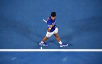 Novak Djokovic reacts after winning his seventh Australian Open title. Picture: @AustralianOpen/Twitter.