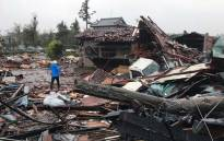 Damaged houses caused by weather patterns from Typhoon Hagibis are seen in Ichihara, Chiba prefecture on 12 October 2019. Powerful Typhoon Hagibis on 12 October claimed its first victim even before making landfall, as potentially record-breaking rains and high winds sparked evacuation orders for more than a million people. Picture: AFP
