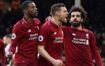 Liverpool's English midfielder James Milner (C) celebrates scoring the team's second goal during the English Premier League football match between Fulham and Liverpool at Craven Cottage in London on 17 March 2019. Picture: AFP