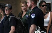 Actress Amy Schumer (in green) waits to be led away after being arrested during a protest against the confirmation of Supreme Court nominee Judge Brett Kavanaugh on 4 October 2018 at the Hart Senate Office Building on Capitol Hill in Washington, DC. Picture: AFP