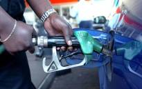Petrol attendant fills up a car tank. Picture: AFP