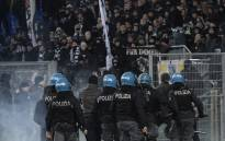 Italian anti-riot policemen stand guard by the curve of Eintracht Frankfurt's fans during the Uefa Europa League group H football match Lazio Rome vs Eintracht Frankfurt on 13 December 2018 at the Olympic stadium in Rome. Picture: AFP