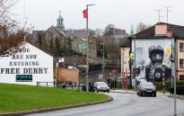 In this file photo cars pass murals in the Bogside area of Derry, Northern Ireland, on 13 March 2019. Picture: AFP