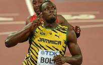 """Jamaica's Usain Bolt celebrates winning the final of the men's 100 metres athletics event at the 2015 IAAF World Championships at the """"Bird's Nest"""" National Stadium in Beijing on 23 August, 2015. Picture: AFP."""