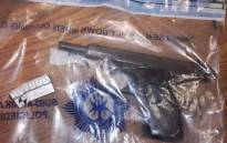 A gun seized by police following an attempted hijacking in Douglasdale, Johannesburg. Picture: @AsktheChiefJMPD/Twitter.
