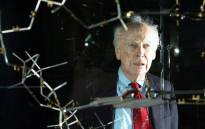 FILE: Dr James Watson with the original DNA model ahead of a press conference at the Science museum in London. Picture: AFP.