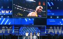 An image of the late Kobe Bryant is projected onto a screen while host Alicia Keys (2nd from L) and (from L) Nathan Morris, Wanya Morris, and Shawn Stockman of music group Boyz II Men perform onstage during the 62nd Annual GRAMMY Awards at STAPLES Center on 26 January 2020 in Los Angeles, California. Picture: AFP