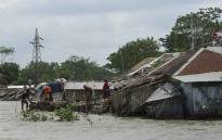 FILE: People fix their damaged homes amid high waters in Khulna on 4 May 2019, as Cyclone Fani reached Bangladesh. Cyclone Fani, one of the biggest to hit India in years, barrelled into Bangladesh on 4 May after leaving a trail of deadly destruction in India. Picture: AFP