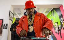 In this file photo taken on 19 January 2019 Curtis Fisher, aka Grandmaster Caz looks at hip-hop memorabilia at the Hip-Hop Museum Pop Up Experience in Washington, DC. Picture: AFP