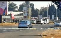 Cash-in-transit heist scene on the corner of Atlas and Lakefield Roads, Boksburg, has been secured by forensic investigators as the incident is assessed. Picture: Louise McAuliffe/EWN.