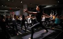 """FILE: Hilaria Baldwin leads a yoga class at the Carbon38 and Hilaria Baldwin Host """"Om For A Cause"""" for Girls, Inc at the Glass Houses on 3December 2018 in New York City. Picture: AFP"""