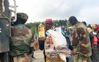 FILE: Distribution of food parcels in Zimbabwe after Hurricane Idai struck the area. AFP