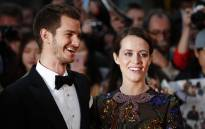 Actor Andrew Garfield (L) and English actress Claire Foy pose upon arrival for the European premiere of the film 'Breathe' during the opening night gala event for the BFI London Film Festival in London on 4 October 2017. Picture: AFP.