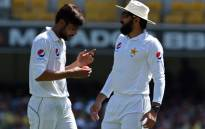 FILE: Pakistan bowler Mohamed Amir (left) and team captain Misbah-ul-Haq(right) plot their tactics. Picture: AFP