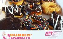 An assortment of Dunkin' Donuts seen in a paper box in Washington DC on 5 June 2015. Picture: Eva Hambach/AFP.