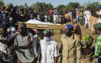 FILE: Mourners attend the funeral of 43 farm workers in Zabarmari, about 20km from Maiduguri, Nigeria, on 29 November 2020 after they were killed by Boko Haram fighters in rice fields near the village of Koshobe on 28 November 2020. Picture: AFP