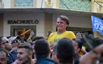 Brazilian right-wing presidential candidate Jair Bolsonaro gestures after being stabbed in the stomach during a campaign rally in Juiz de Fora, Minas Gerais State, in southern Brazil, on 6 September, 2018. Picture: AFP