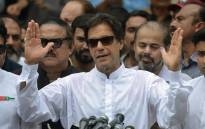 Pakistan's cricketer-turned politician Imran Khan of the Pakistan Tehreek-e-Insaf (Movement for Justice) speaks to the media after casting his vote at a polling station during the general election in Islamabad on 25 July 2018. Picture: AFP