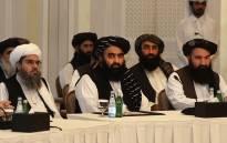 Members of the Taliban delegation Shahabuddin Delawar (L), Amir Khan Muttaqi, and Khairullah Khairkhwa (R) meet with foreign diplomats in Qatar's capital Doha, on 12 October 2021. Picture: KARIM JAAFAR/AFP