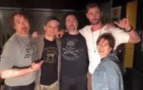 A screengrab shows 'Avengers' cast members Robert John Downey Jr,  Jeremy Renner, Chris Hemsworth and Scarlett Johansson posing with a tattoo artist (centre). Picture: instagram.com