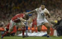 FILE: England's centre Manu Tuilagi (R) tries to hand-off a tackled during the Six Nations international rugby union match between Wales in 2013. Picture: AFP
