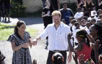 FILE: Prince Harry, Duke of Sussex and Meghan Duchess of Sussex arrive to visit 'Justice desk', an NGO in the township of Nyanga in Cape Town, as they begin their tour of the region on 23 September 2019. Picture: AFP
