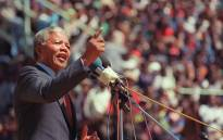 Anti-apartheid leader and African National Congress (ANC) member Nelson Mandela addresses at a funeral of 12 people died during recent township unrests in Soweto, 20 September 1990, in Soweto. Picture: AFP.