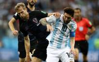 Argentina's Lionel Messi (right) tries to lose his Croatian opponent during their 2018 World Cup match on 21 June 2018. Picture: @Argentina/Twitter