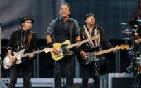 US singer and guitarist Bruce Springsteen (C) performs during his concert at the Molinon stadium in Gijon, northern Spain, on 26 June, 2013. Picture:AFP
