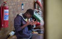 A displaced foreign national says a prayer at the DK Williams Community Centre in Katlehong. Picture: Kayleen Morgan/EWN