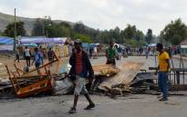 A file picture taken on 15 December, 2015 shows Ethiopians from the Oromo group blocking a road in Ethiopia after protesters were shot dead by security forces in Wolenkomi, some 60km West of Addis Ababa. Picture: AFP.