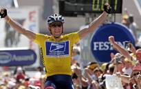 Lance Armstrong celebrating as he crosses the finish line and wins the Tour de France cycling race. Picture: AFP